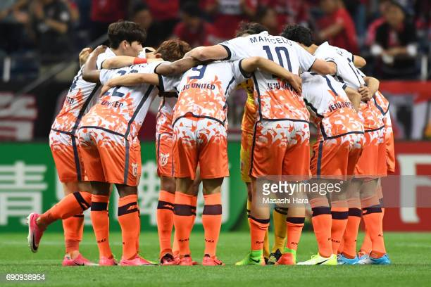 Players of Jeju United FC huddle during the AFC Champions League Round of 16 match between Urawa Red Diamonds and Jeju United FC at Saitama Stadium...