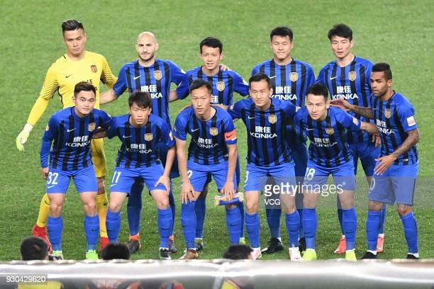 Players of Jiangsu Suning line up during 2018 Ping An Chinese Football Association Super League second round match between Jiangsu Suning FC and...