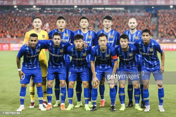 Players of Jiangsu Suning line up prior to the 2019 Chinese Football Association Super League 18th round match between Wuhan Zall and Jiangsu Suning...