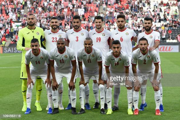 Players of Jordan line up for the team photo prior to the AFC Asian Cup Group B match between Palestine and Jordan at Mohammed Bin Zayed Stadium on...