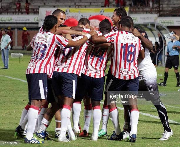 Players of Junior celebrate a goal during a match between Cucuta and Junior as part of the Liga Postobon II at General Santander Stadium on August 21...