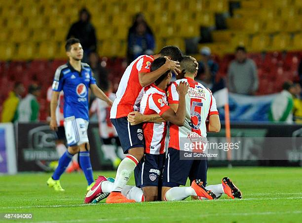 Players of Junior celebrate the second goal of their team scorde by Guillermo Celis during a match between Millonarios and Junior as part of Liga...