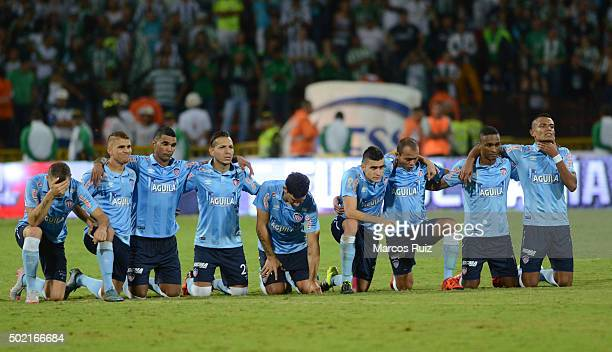 Players of Junior look on during the penalty shootout during a second leg final match between Atletico Nacional and Atletico Junior as part of Liga...