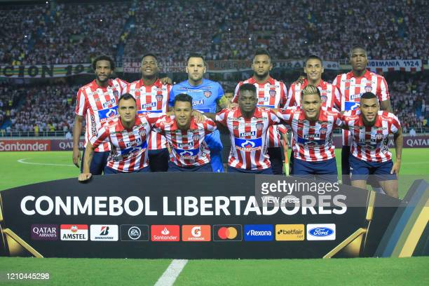 Players of Junior pose for the team photo before the group A match of Copa CONMEBOL Libertadores between Junior and Flamengo at Estadio Metropolitano...