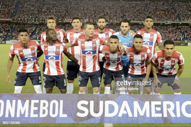 Players of Junior pose to a photo during the formal events prior a second leg match between Junior and Cerro Porteño as part of round of 16 of Copa...