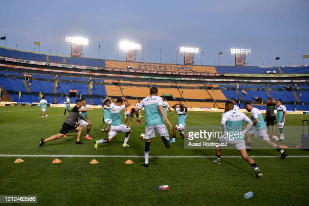 Players of Juárez warm up in an empty stadium prior to the 10th round match between Tigres UANL and FC Juarez as part of the Torneo Clausura 2020...