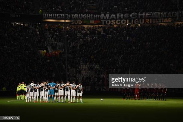 Players of Juventus and Milan observe a minute of silence in memory of Emiliano Mondonico during the serie A match between Juventus and AC Milan at...