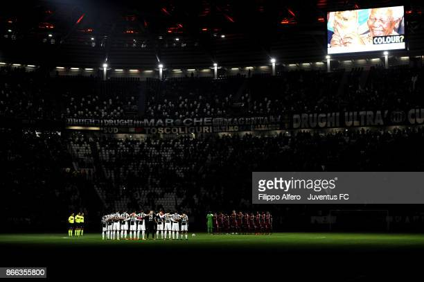 Players of Juventus and Spal listen to a speaker reading a passage from the diary of holocaust victim Anne Frank before the Serie A match between...