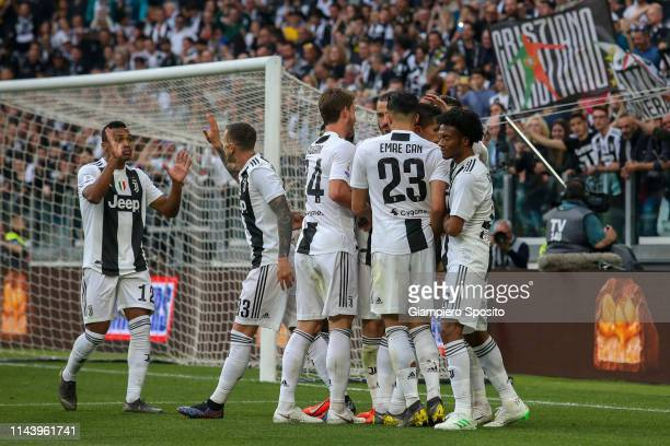 Players of Juventus celebrate after German Pezzella of ACF Fiorentina scored an own goal during the Serie A match between Juventus and ACF Fiorentina...
