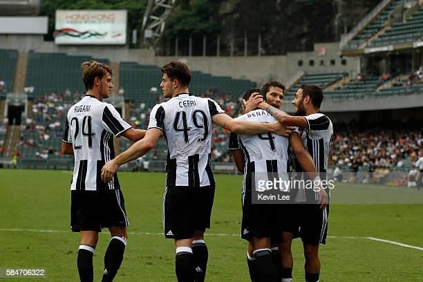 Players of Juventus celebrate after Medhi Benatia scored a goal during the match between Juventus FC and South China of Hong Kong at Hong Kong...