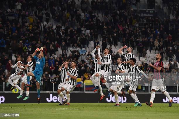 Players of Juventus celebrate after winning the serie A match between Juventus and AC Milan at Allianz Stadium on March 31 2018 in Turin Italy