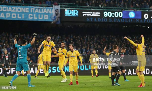 Players of Juventus celebrate the victory beside the disappointment of players of SSC Napoli after the Serie A match between SSC Napoli and Juventus...