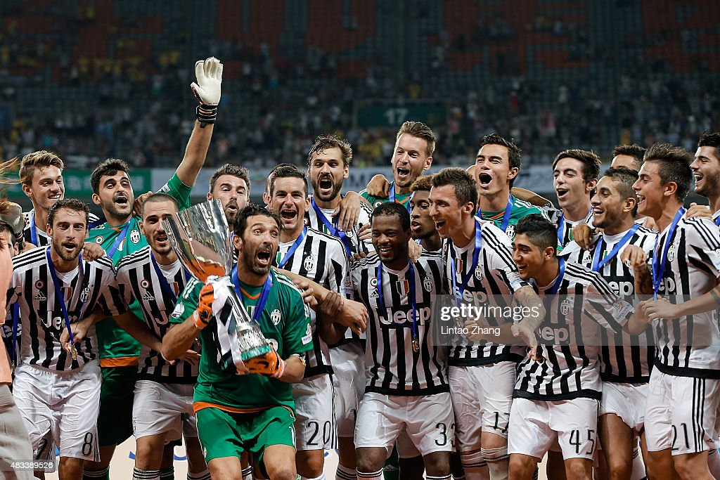 Players of Juventus celebrate the victory of Italian Super Cup final football match between Juventus and Lazio at Shanghai Stadium on August 8, 2015 in Shanghai, China.