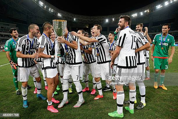 Players of Juventus celebrate the victory of Italian Super Cup final football match between Juventus and Lazio at Shanghai Stadium on August 8, 2015...