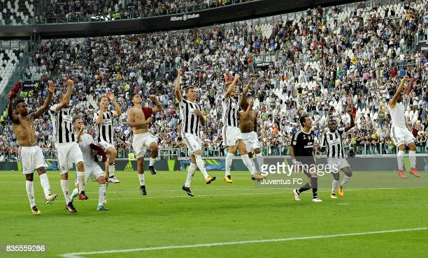 players of Juventus celebrate victory at the end of the Serie A match between Juventus and Cagliari Calcio at Allianz Stadium on August 19 2017 in...
