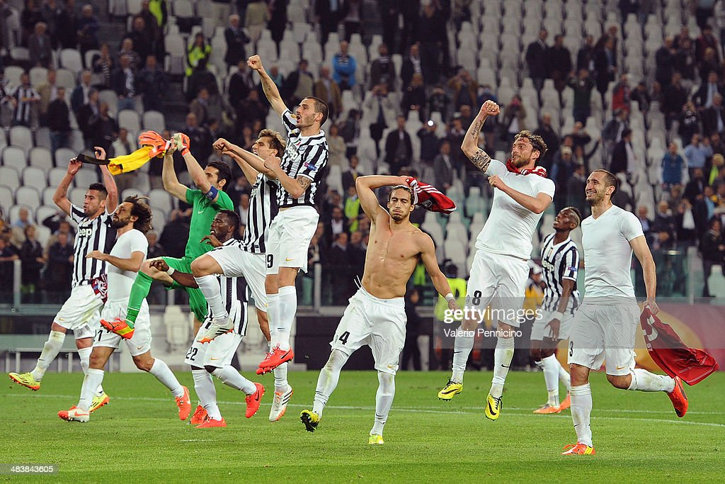 Players of Juventus celebrate victory at the end of the UEFA Europa League quarter final match between Juventus and Olympique Lyonnais at Juventus Arena on April 10, 2014 in Turin, Italy.