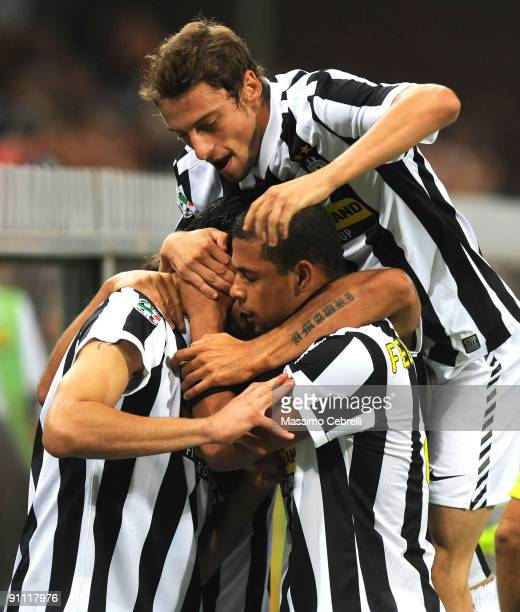 Players of Juventus FC celebrate the first goal scored by Vincenzo Iaquinta during the Serie A match between Genoa CFC and SSC Juventus FC at Stadio...
