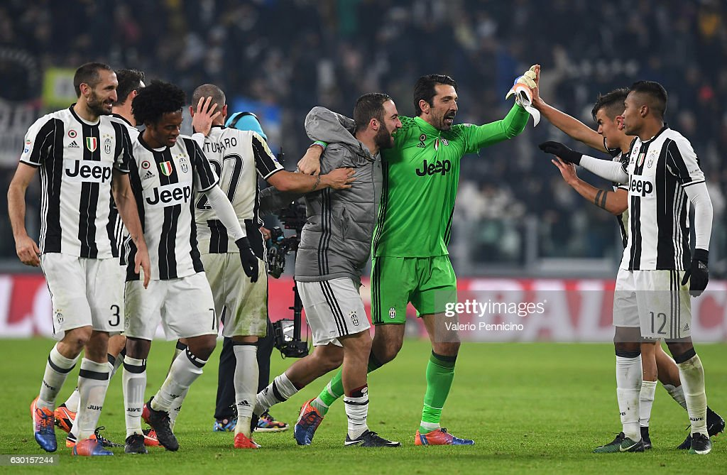 Players of Juventus FC celebrate victory at the end of the Serie A match between Juventus FC and AS Roma at Juventus Stadium on December 17, 2016 in Turin, Italy.