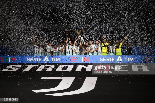 Players of Juventus FC celebrate with the trophy during the award ceremony for Serie A 2019-2020 title at end of the Serie A football match between...