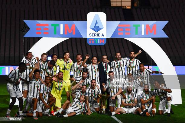 Players of Juventus FC celebrate with the trophy during the award ceremony for Serie A 20192020 title at end of the Serie A football match between...