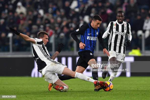 Players of Juventus Mario Mandzukic and Blaise Matuidi in action against Matias Vecino of FC Internazionale during the Serie A match between Juventus...