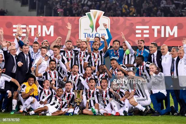 Players of Juventus pose with the trophy after the TIM Cup Coppa Italia final match between Juventus and AC Milan at Stadio Olimpico Rome Italy on 9...