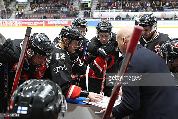 players of JYP Jyvaskyla going through the gameplan during the timeout in the third period of Champions Hockey League Round of 16 match between JYP...