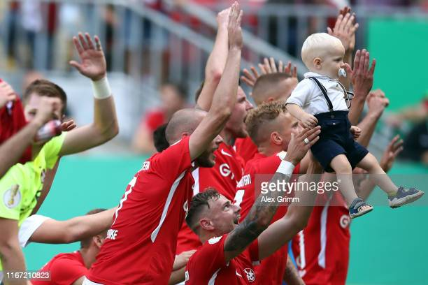 Players of Kaiserslautern celebrate after the DFB Cup first round match between 1 FC Kaiserslautern and 1 FSV Mainz 05 at FritzWalterStadion on...