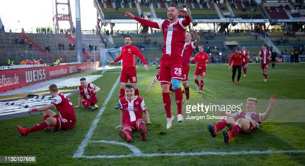 Players of Kaiserslautern celebrate after winning the 3 Liga match between Karlsruher SC and 1 FC Kaiserslautern at Wildparkstadion on February 16...