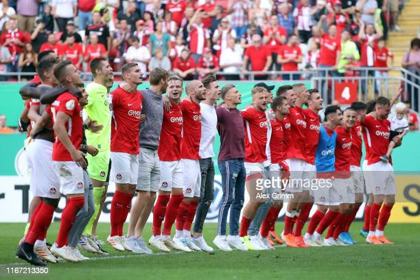 Players of Kaiserslautern celebrate with the fans after the DFB Cup first round match between 1 FC Kaiserslautern and 1 FSV Mainz 05 at...