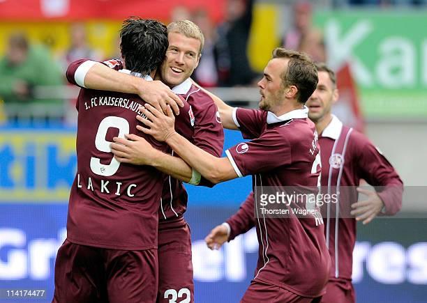 Players of Kaiserslautern celebrates after Adam Nemec is scoring his team's first goal during the Bundesliga match between 1FC Kaiserslautern and SV...