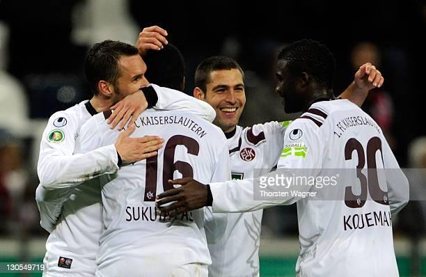 Players of Kaiserslautern celebrates after winning the DFB Cup second round match between Eintracht Frankfurt and 1FC Kaiserslautern at...