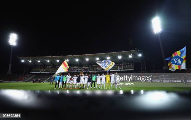 Players of Karlsruhe celebrate with the fans after the 3 Liga match between Karlsruher SC and SG Sonnenhof Grossaspach at Wildparkstadion on March 7...