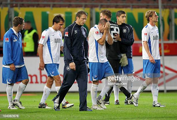 Players of Karlsruhe show their frustration after the Second Bundesliga match between FC Energie Cottbus and Karlsruher SC at Stadion der...