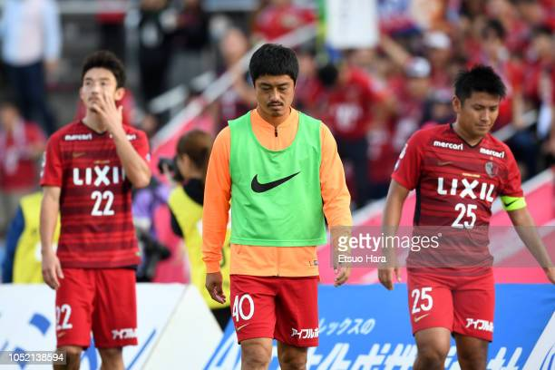 Players of Kashima Antlers show dejection after the JLeague Levain Cup semi final second leg match between Yokohama FMarinos and Kashima Antlers at...