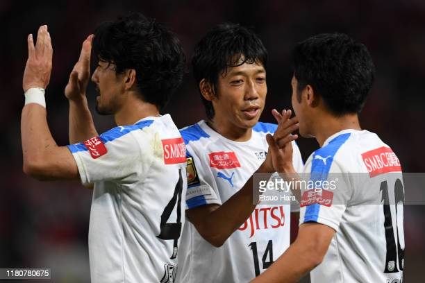 Players of Kawasaki Frontale celebrate after the J.League Levain Cup semi final second leg match between Kashima Antlers and Kawasaki Frontale at...