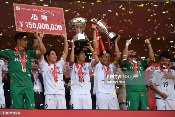 Players of Kawasaki Frontale celebrate as captain,Yu Kobayashi lifts the trophy after the J.League Levain Cup Final between Consadole Sapporo and...
