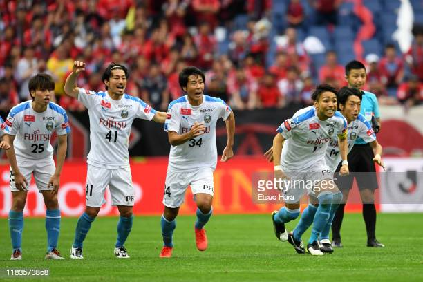 Players of Kawasaki Frontale celebrate the victory at the end of the J.League Levain Cup Final between Consadole Sapporo and Kawasaki Frontale at...