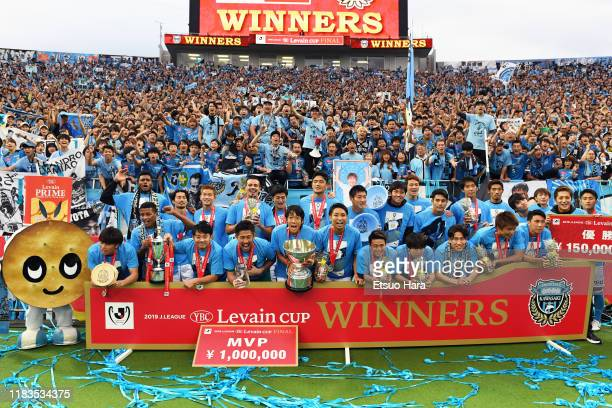 Players of Kawasaki Frontale celebrate the victory with the trophy after the J.League Levain Cup Final between Consadole Sapporo and Kawasaki...