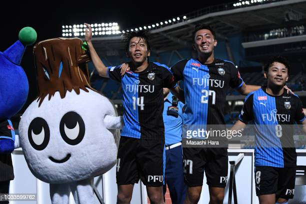 Players of Kawasaki Frontale celebrate the win after the JLeague J1 match between Kawasaki Frontale and Consadole Sapporo at Todoroki Stadium on...