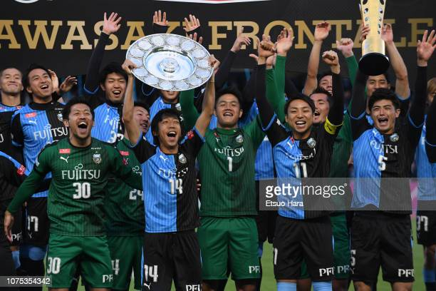 Players of Kawasaki Frontale celebrate their victory with trophy after the JLeague J1 match between Kawasaki Frontale and Jubilo Iwata at Todoroki...