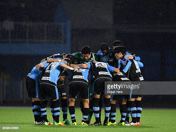 Players of Kawasaki Frontale huddle during the Emperor's Cup third round match between Kawasaki Frontale and JEF United Chiba at Todoroki Stadium on...