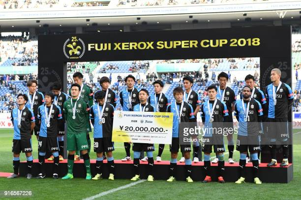 Players of Kawasaki Frontale show dejection during the medal ceremony after the Xerox Super Cup match between Kawasaki Frontale and Cerezo Osaka at...