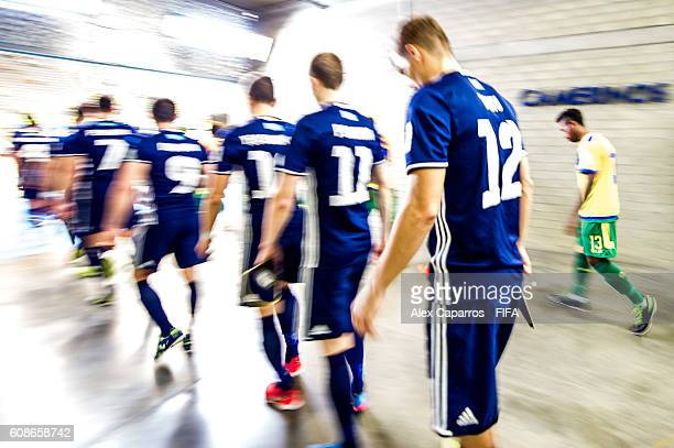 Players of Kazakhstan and Solomon Islands enter the pitch before the FIFA Futsal World Cup Group E match between Kazakhstan and Solomon Islands at...