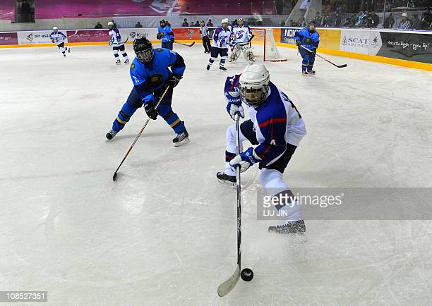 Players of Kazakhstan and South Korea compete during the women's ice hockey tournament match between Kazakhstan and South Korea at Buluan Sholak...