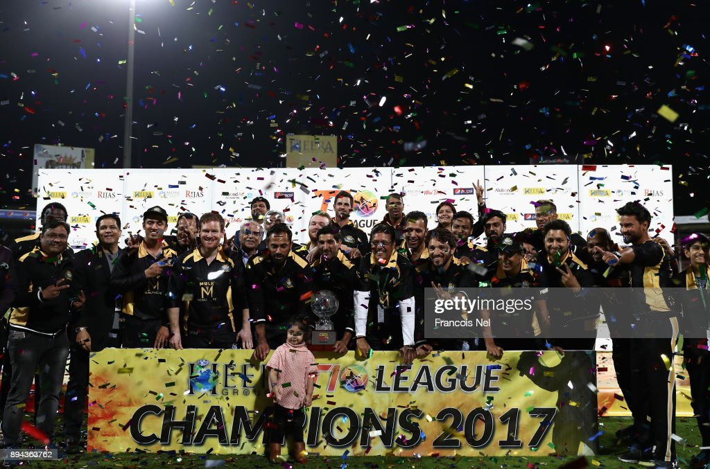 Players of Kerela Kings celebrate on the podium after winning the T10 League Final match at Sharjah Cricket Stadium on December 17, 2017 in Sharjah, United Arab Emirates.