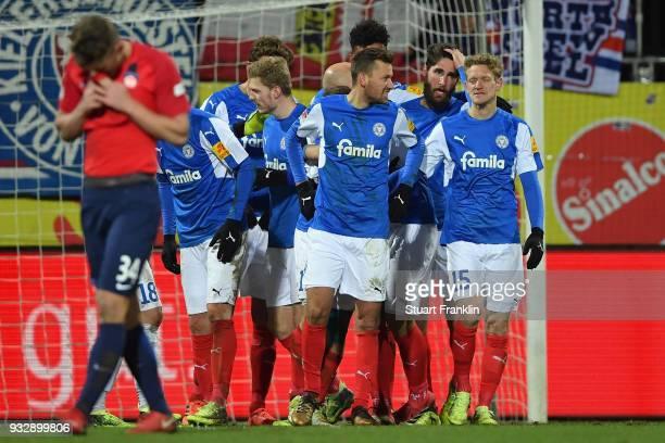 Players of Kiel celebrate after the Second Bundesliga match between Holstein Kiel and 1 FC Heidenheim 1846 at HolsteinStadion on March 16 2018 in...