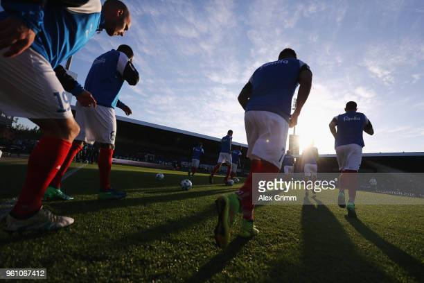 Players of Kiel enter the pitch to warm up for the Bundesliga Playoff Leg 2 match between Holstein Kiel and VfL Wolfsburg at HolsteinStadion on May...