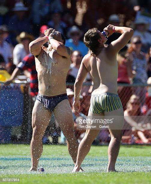 Players of knocked out teams who failed to score a try drink beer during their 'jocks run' during the Pub Charity Rugby Sevens 2012 New Zealand...