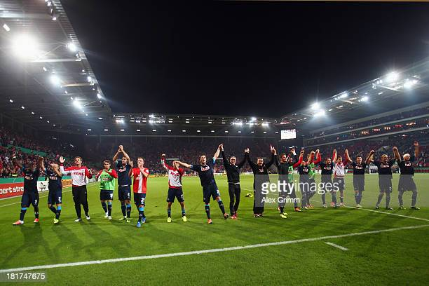 Players of Koeln celebrate after the DFB Cup second round match between 1 FSV Mainz 05 and 1 FC Koeln at Coface Arena on September 24 2013 in Mainz...